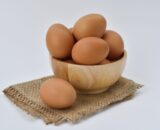 brown eggs on brown wooden bowl on beige knit textile 162712 scaled